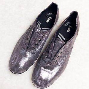 Size 8 Metallic Silver Keds sneakers